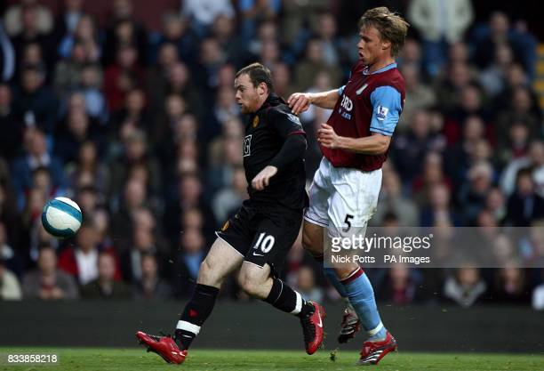 Manchester United's Wayne Rooney and Aston Villa's Martin Laursen battle for the ball