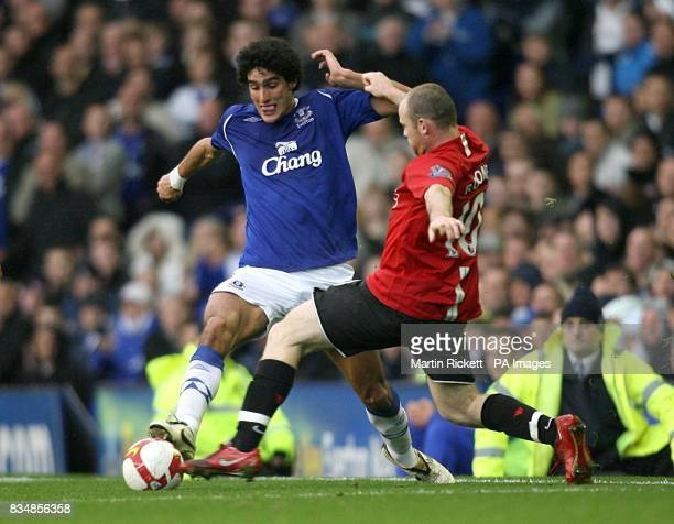 Manchester United's Wayne Rooney and Everton's Marouane Fellaini battle for the ball