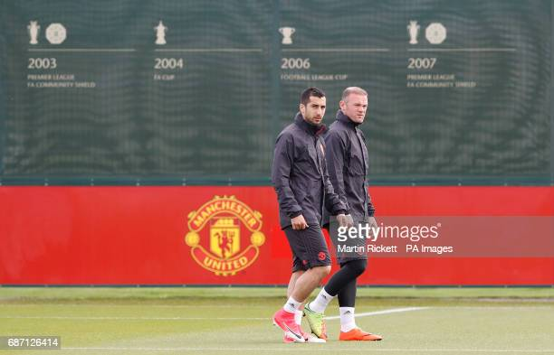 Manchester United's Wayne Rooney and Henrikh Mkhitaryan during the training session at the AON Training Complex in Carrington ahead of the Europa...