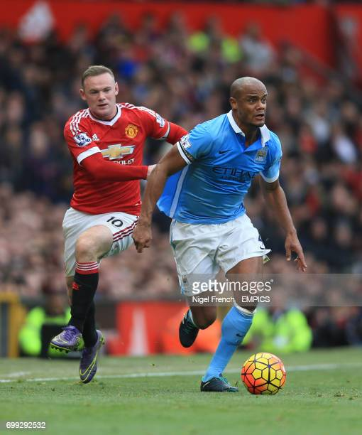 Manchester United's Wayne Rooney and Manchester City's Vincent Kompany battle for the ball