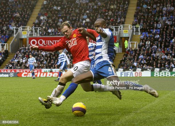 Manchester United's Wayne Rooney and Reading's Kalifa Cisse battle for the ball