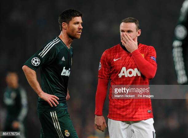 Manchester United's Wayne Rooney and Real Madrid's Xabi Alonso