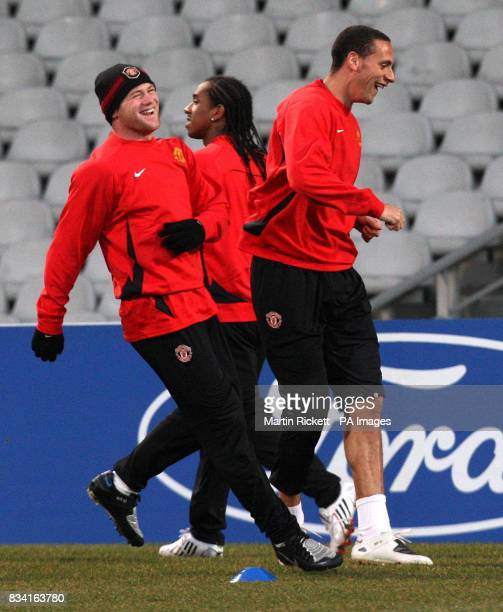 Manchester United's Wayne Rooney and Rio Ferdinand during a training at the Stade Gerland in Lyon France