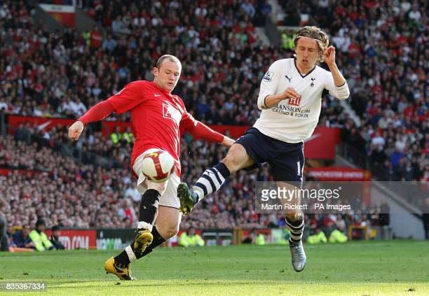 Manchester United's Wayne Rooney and Tottenham Hotspur's Luka Modric battle for the ball