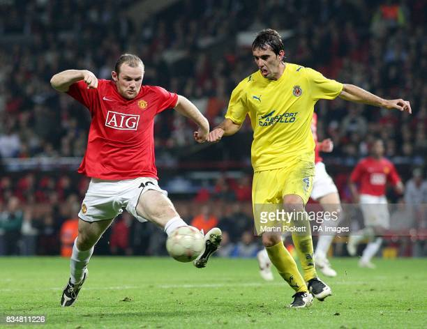 Manchester United's Wayne Rooney and Villarreal's Diego Godin in action