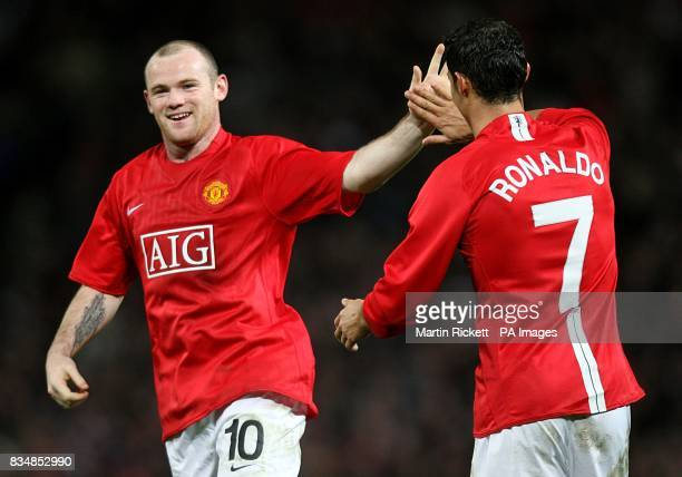 Manchester United's Wayne Rooney celebrates after scoring the third goal of the game with team mate Cristiano Ronaldo
