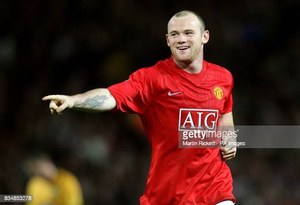 Manchester United's Wayne Rooney celebrates after scoring the third goal of the game