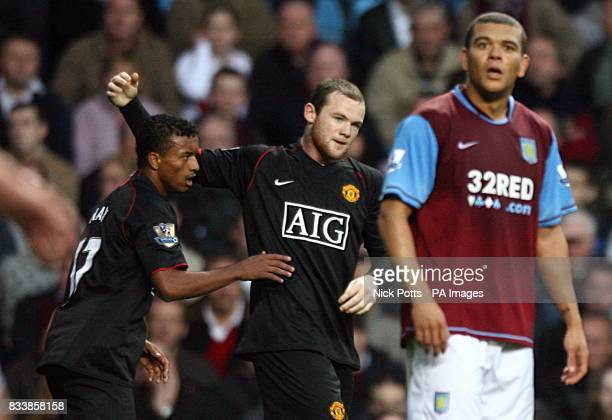 Manchester United's Wayne Rooney celebrates bringing his side back on level terms with team mate Luis Nani