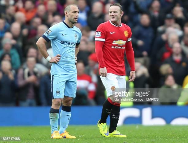 Manchester United's Wayne Rooney celebrates his goal as Manchester City's Pablo Zabaleta looks dejected