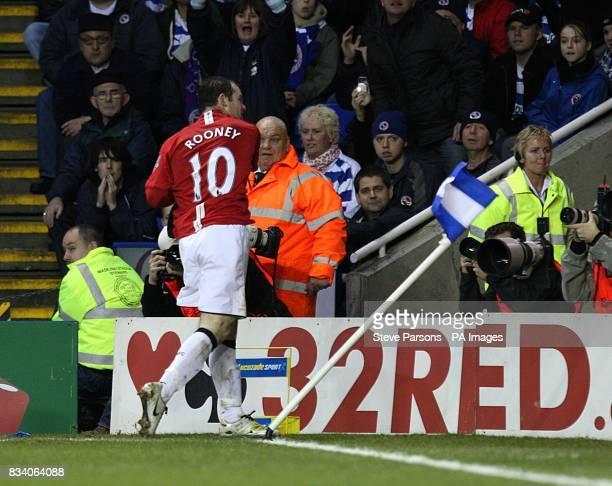 Manchester United's Wayne Rooney celebrates scoring by punching the corner flag