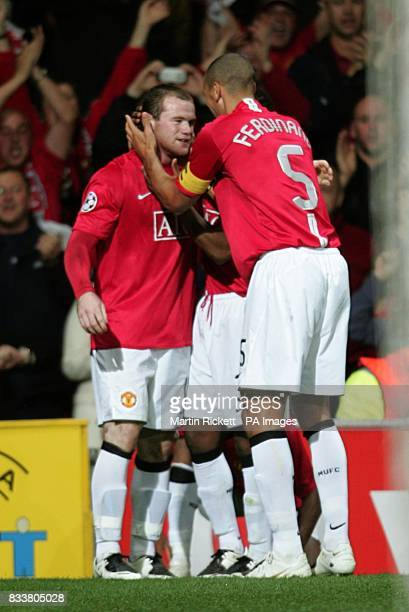 Manchester United's Wayne Rooney celebrates scoring his sides first goal of the game with teammate Rio Ferdinand