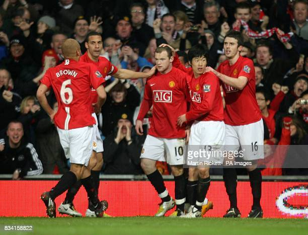 Manchester United's Wayne Rooney celebrates scoring his sides first goal of the game with teammates