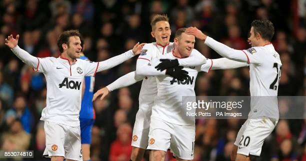 Manchester United's Wayne Rooney celebrates scoring his side's second goal with teammates Juan Mata Adnan Januzaj and Robin van Persie