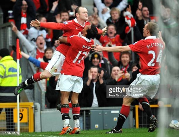 Manchester United's Wayne Rooney celebrates with team mates Luis Nani and Darren Fletcher after scoring his side's second goal of the game