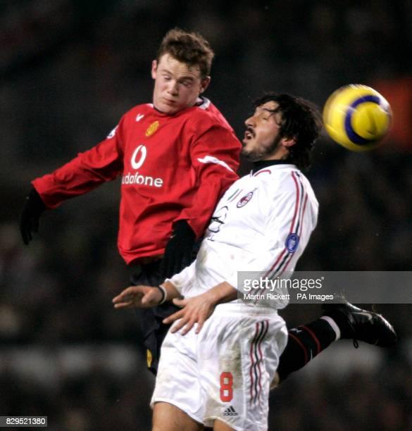 Manchester United's Wayne Rooney challenges AC Milan's Gennaro Gattuso