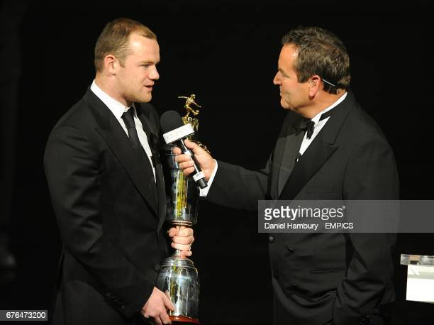 Manchester United's Wayne Rooney collects the PFA Players Player of the Year award on stage with Jeff Stelling at the PFA Player of the Year Awards...