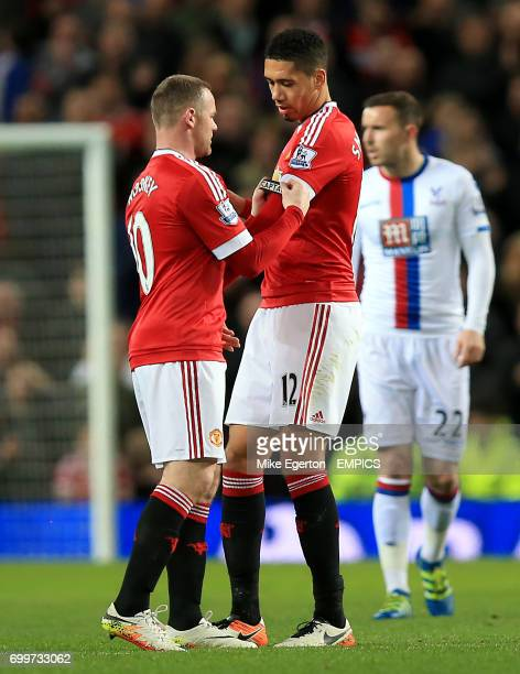 Manchester United's Wayne Rooney gives the captains armband to Manchester United's Chris Smalling