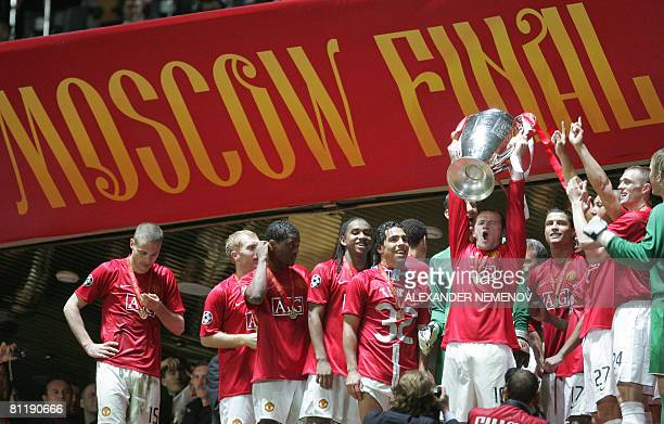 Manchester United's Wayne Rooney holds up the trophy after beating Chelsea in the final of the UEFA Champions League football match at the Luzhniki...