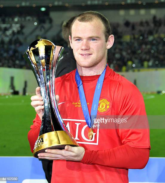 Manchester United's Wayne Rooney is all smiles as he holds the trophy of the FIFA Club World Cup in Yokohama on December 21 2008 Manchester United...