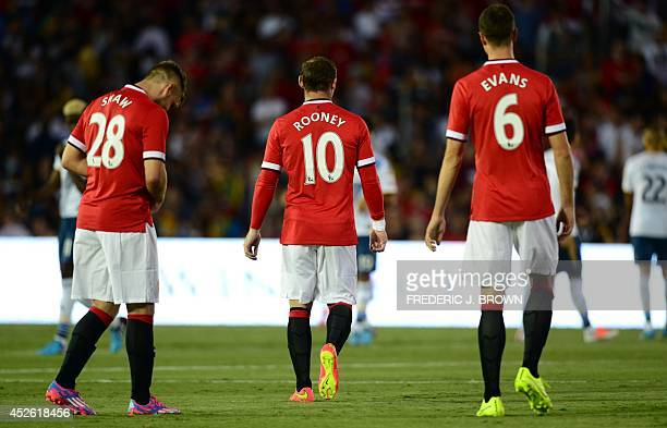 Manchester United's Wayne Rooney Luke Shaw and Jonny Evans take to the pitch ahead of kickoff against the LA Galaxy in their Chevrolet Cup match at...