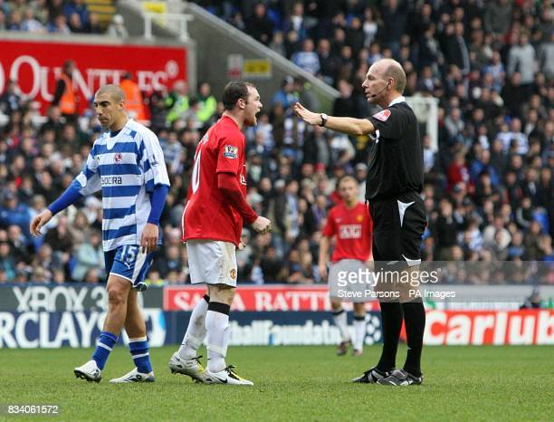Manchester United's Wayne Rooney shouts at referee Steve Bennett