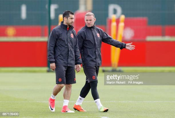 Manchester United's Wayne Rooney speaks with Henrikh Mkhitaryan during the training session at the AON Training Complex in Carrington ahead of the...