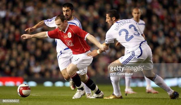 Manchester United's Wayne Rooney vies with Europe XI's Marco Materazzi and Gennaro Gattuso 13 March 2007 during their charity football match in...