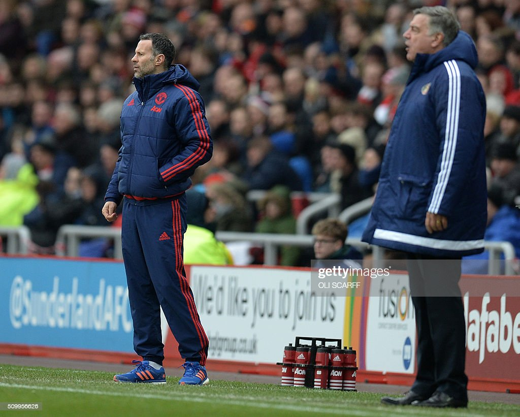 Manchester United's Welsh assistant manager Ryan Giggs (L) and Sunderland's English manager Sam Allardyce shout instructions to their players from the touchline during the English Premier League football match between Sunderland and Manchester United at the Stadium of Light in Sunderland, northeast England on February 13, 2016. / AFP / OLI SCARFF / RESTRICTED TO EDITORIAL USE. No use with unauthorized audio, video, data, fixture lists, club/league logos or 'live' services. Online in-match use limited to 75 images, no video emulation. No use in betting, games or single club/league/player publications. /