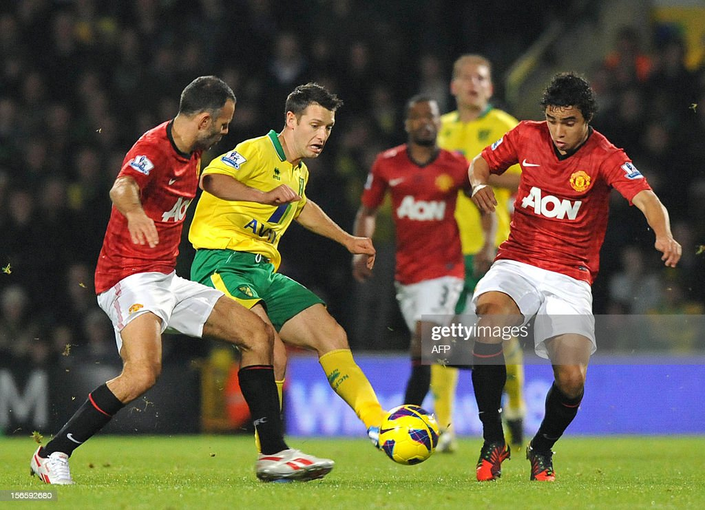 "Manchester United's Welsh midfielder Ryan Giggs (L) and Brazilian defender Rafael (R) vie with Norwich City's Irish midfielder Wes Hoolahan (2nd L) during the English Premier League football match between Norwich City and Manchester United at Carrow Road stadium in Norwich, England on November 17, 2012. Norwich City won the game 1-0. USE. No use with unauthorized audio, video, data, fixture lists, club/league logos or ""live"" services. Online in-match use limited to 45 images, no video emulation. No use in betting, games or single club/league/player publications."