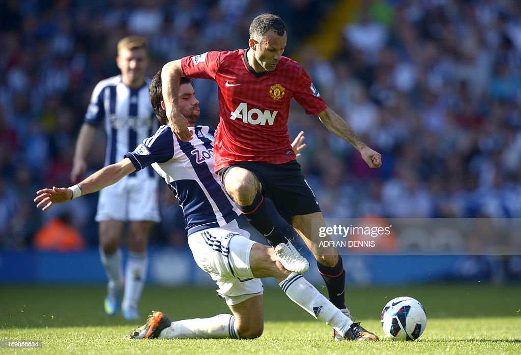 """Manchester United's Welsh midfielder Ryan Giggs (R) is challenged by West Bromwich Albion's Argentinian midfielder Claudio Yacob during the English Premier League football match between West Bromwich Albion and Manchester United at The Hawthorns in West Bromwich, central England, on May 19, 2013. USE. No use with unauthorized audio, video, data, fixture lists, club/league logos or """"live"""" services. Online in-match use limited to 45 images, no video emulation. No use in betting, games or single club/league/player publications."""