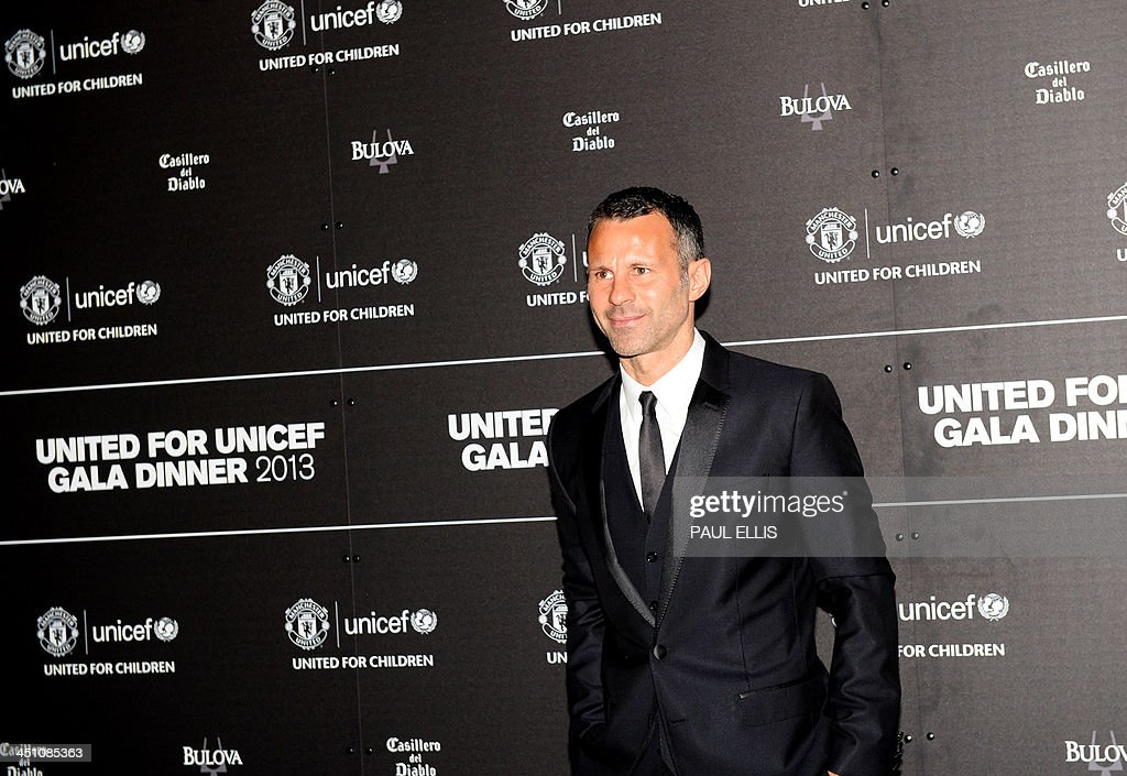 Manchester United's Welsh midfielder Ryan Giggs poses for photographs as he arrives for a gala dinner in aid of UNICEF at Old Trafford in Manchester on November 21, 2013.