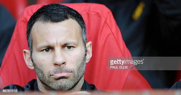 Manchester United's Welsh midfielder Ryan Giggs takes his seat on the substitutes bench before the UEFA Champions league semifinal first leg football...