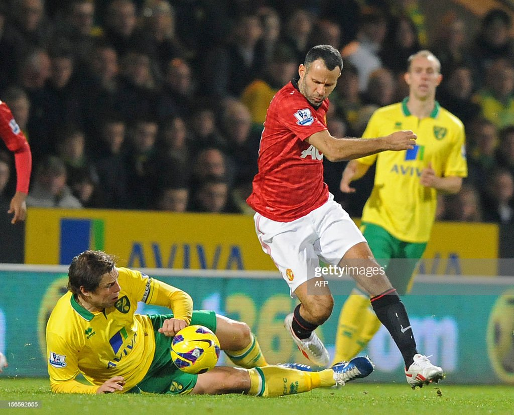 "Manchester United's Welsh midfielder Ryan Giggs (R) vies with Norwich City's English striker Grant Holt (L) during the English Premier League football match between Norwich City and Manchester United at Carrow Road stadium in Norwich, England on November 17, 2012. Norwich City won the game 1-0. USE. No use with unauthorized audio, video, data, fixture lists, club/league logos or ""live"" services. Online in-match use limited to 45 images, no video emulation. No use in betting, games or single club/league/player publications."