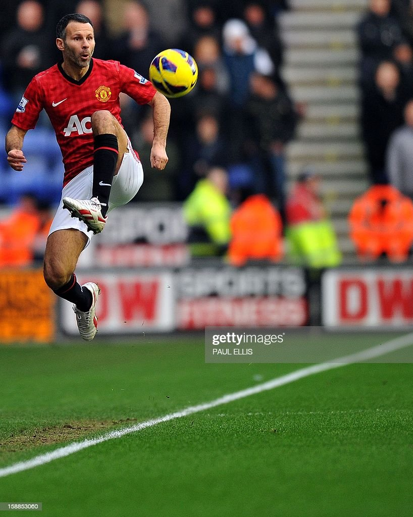 "Manchester United's Welsh player Ryan Giggs controls the ball during the English Premier League football match during between Wigan Athletic and Manchester United at The DW Stadium in Wigan, north-west England on January 1, 2013. USE. No use with unauthorized audio, video, data, fixture lists, club/league logos or ""live"" services. Online in-match use limited to 45 images, no video emulation. No use in betting, games or single club/league/player publications"