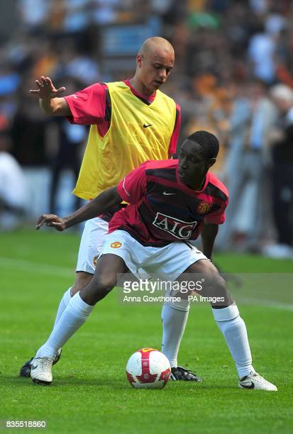 Manchester United's Wes Brown and Danny Welbeck warm up prior to kick off