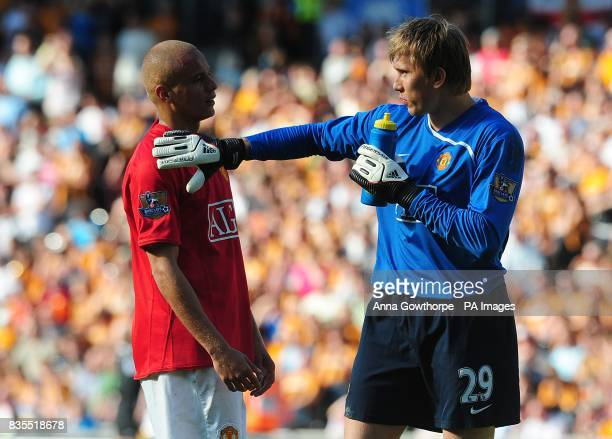 Manchester United's Wes Brown and goalkeeper Tomasz Kuszczak take a break