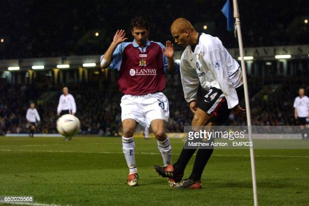 Manchester United's Wes Brown clears the ball as he is closed down by Burnley's Dimitrios Papadopoulos