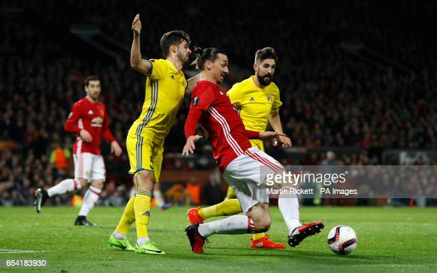 Manchester United's Zlatan Ibrahimovic and FC Rostov's Denis Terentjev battle for the ball during the UEFA Europa League Round of Sixteen Second Leg...