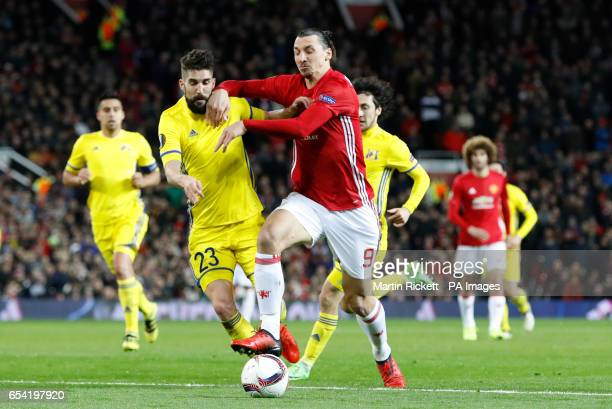 Manchester United's Zlatan Ibrahimovic and FC Rostov's Miha Mevlja battle for the ball during the UEFA Europa League Round of Sixteen Second Leg...