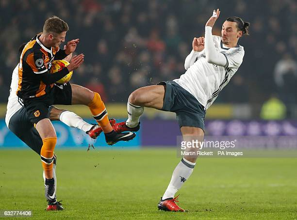 Manchester United's Zlatan Ibrahimovic and Hull City's Josh Tymon in action during the EFL Cup Semi Final Second Leg match at the KCOM Stadium Hull