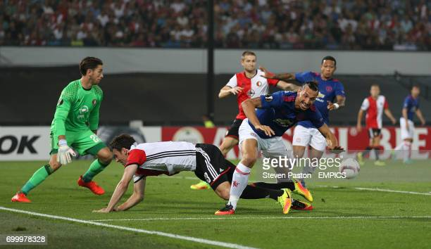 Manchester United's Zlatan Ibrahimovic battles against the Feyenoord defence