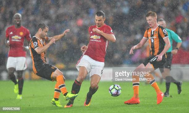 Manchester United's Zlatan Ibrahimovic battles with the Hull City defence