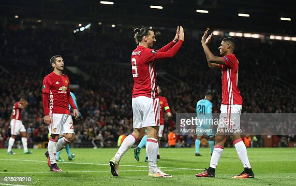 Manchester United's Zlatan Ibrahimovic celebrates his side's third goal with teammate Marcus Rashford during the UEFA Europa League match at Old...