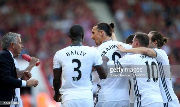 Manchester United's Zlatan Ibrahimovic celebrates scoring his side's third goal of the game with manager Jose Mourinho