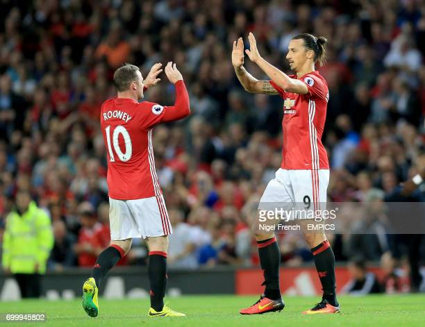 Manchester United's Zlatan Ibrahimovic celebrates scoring his side's first goal of the game with teammate Wayne Rooney