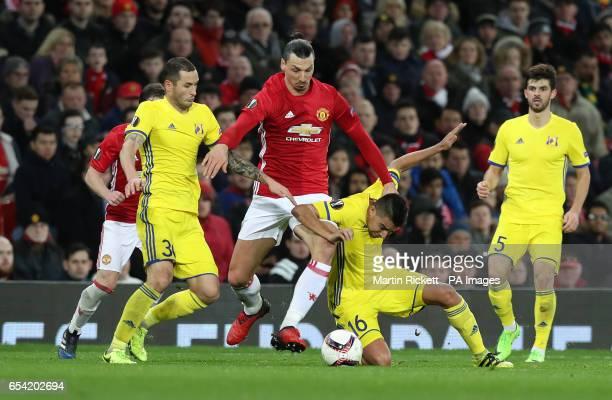 Manchester United's Zlatan Ibrahimovic is tackled by FC Rostov's Fedor Kudryashov and Cristian Noboa during the UEFA Europa League Round of Sixteen...