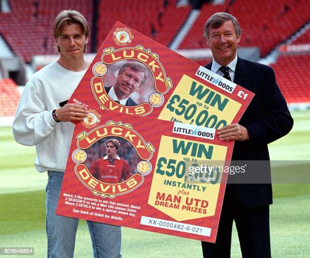Manchester Utd manager Alex Ferguson and player David Beckham launch the 'Lucky Devils' lottery scratchcard a first for a UK football club at Old...