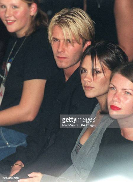 Manchester Utd soccer star David Beckham and girlfriend Victoria Adams watch the catwalk show of young British designer Antonio Berardi tonight the...