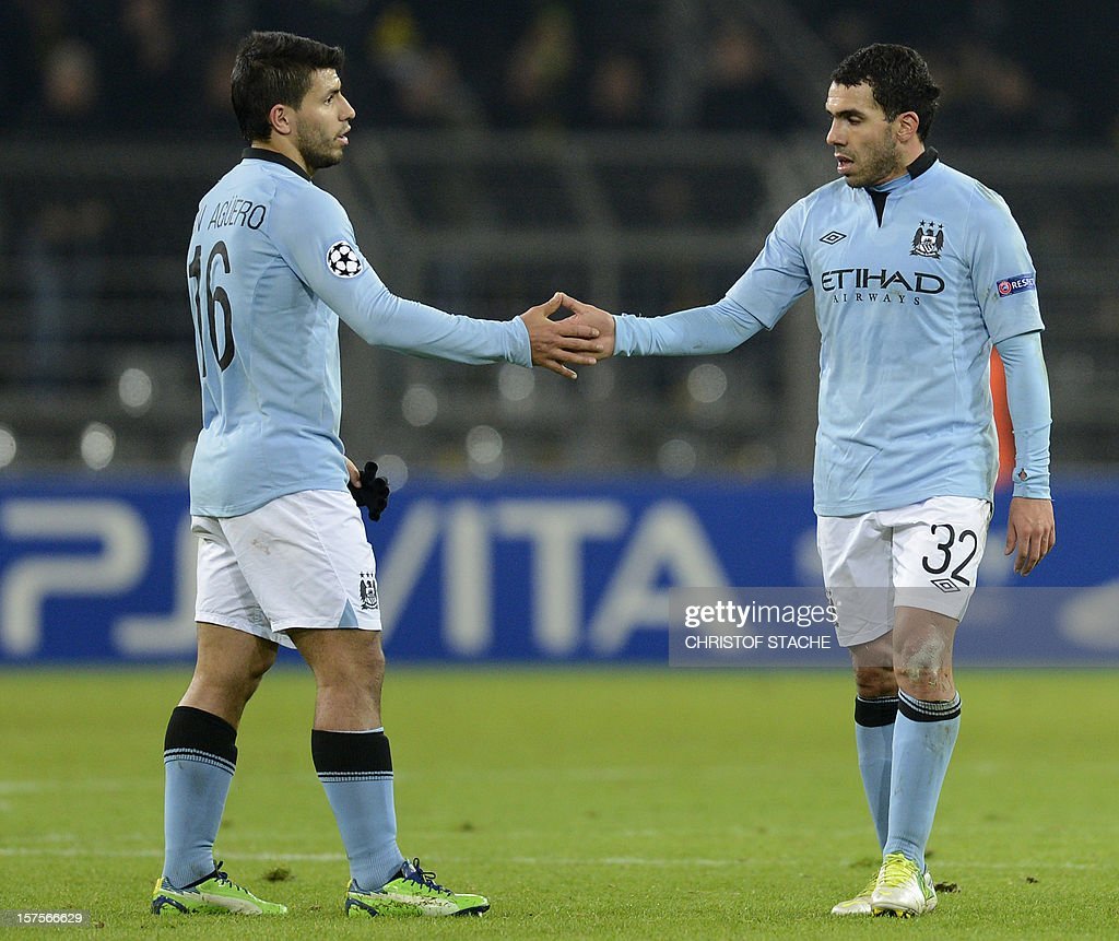 Manchester's Argentine Sergio Aguero (L) and Carlos Tevez shake hands after the UEFA Champions League Group D football match Borrusia Dortmund vs Manchester City in Dortmund, western Germany on December 4, 2012.