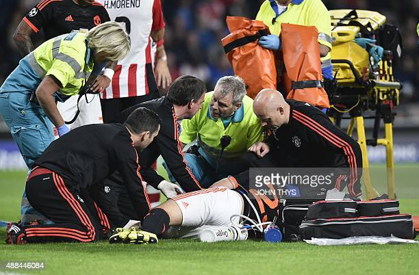 Manchester's defender Luke Shaw receives treatment for a double fracture of the leg during the UEFA Champions League Group B football match between...